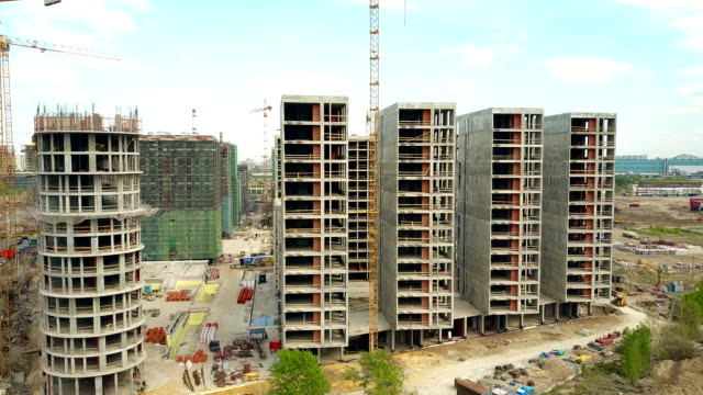 Aerial shot of a modern apartment buildings construction site. FullHD video video