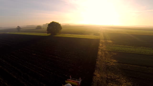 HD: Aerial Shot Of A Tractor In The Field video