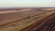 Aerial shot of a tractor plowing video