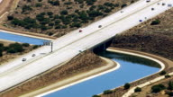 Aerial shot of aqueduct and freeway video