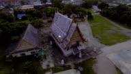 Aerial Shot of Beautiful Ancient Thai-Style Temple with Pink Color video