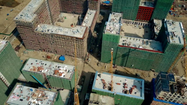 Aerial shot of big construction site. Rooftops of unfinished modern apartment buildings. FullHD video video