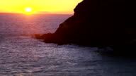 Aerial shot of California coastline at sunset video