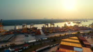 Aerial shot of Cargo Container port at sunset video