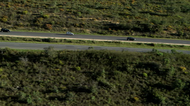 Aerial shot of cars travelling along scenic South African mountain pass, Du Toit's Kloof, Western Cape. Daytime, following as cars proceed along highway video