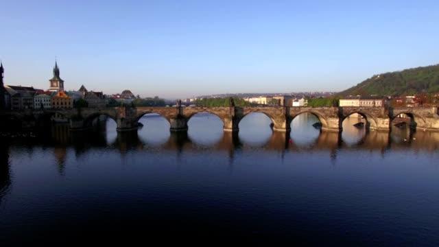 Aerial shot of Charles Bridge over Vltava river in Prague video