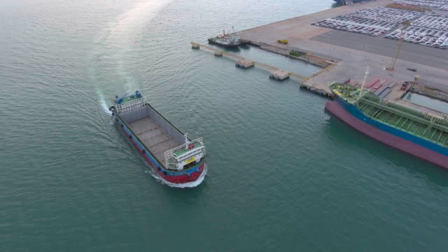 Aerial shot of container ship at peir video