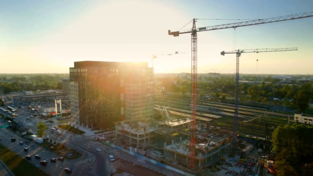 Aerial Shot of Cranes on a Construction Site. Great Cityscape is Visible in Sunlight. video