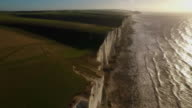Aerial shot of Cuckmere Haven, Sussex in early morning golden light. video
