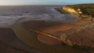 Aerial shot of Cuckmere Haven, Sussex in morning light. video
