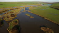 Aerial shot of Cuckmere River, flood plains and surrounding area video