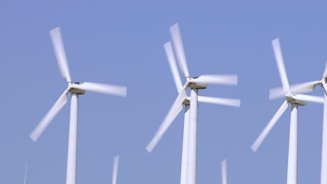 Aerial shot of energy producing wind turbines video