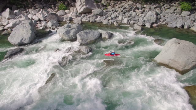 Aerial Shot of Guy in Kayak Paddling Rapids in River Current video