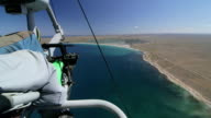 Aerial shot of hang gliding over sea coast video