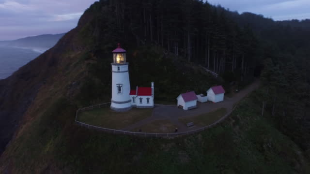 Aerial shot of Heceta Head Lighthouse at sunset video