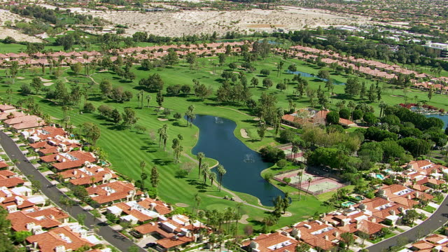 Aerial shot of Palm Springs, California golf course video