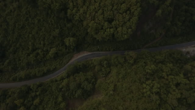 aerial shot of road in the hill video