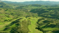 Aerial shot of rolling green hills video