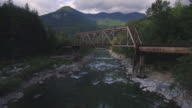 Aerial Shot of Rusty Old Train Bridge Over Skykomish River in Pacific Northwest video