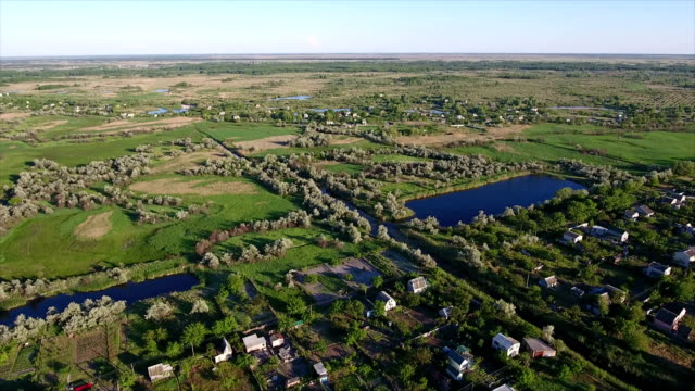 Aerial shot of small lakes, summer cottages and reedbeds in Ukraine in summer video