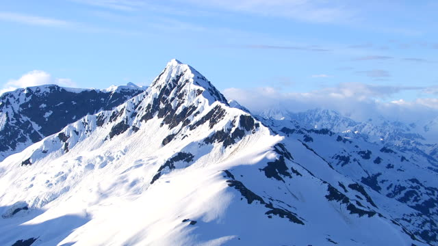 Aerial shot of snowy mountain peak, Alaska video