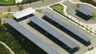 Aerial shot of solar panels over cars in parking lot video