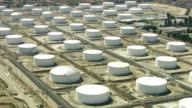 Aerial shot of storage tanks at oil refinery video