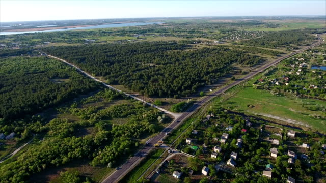 Aerial shot of summer cottages, country road, a small lake nearby in Ukraine video