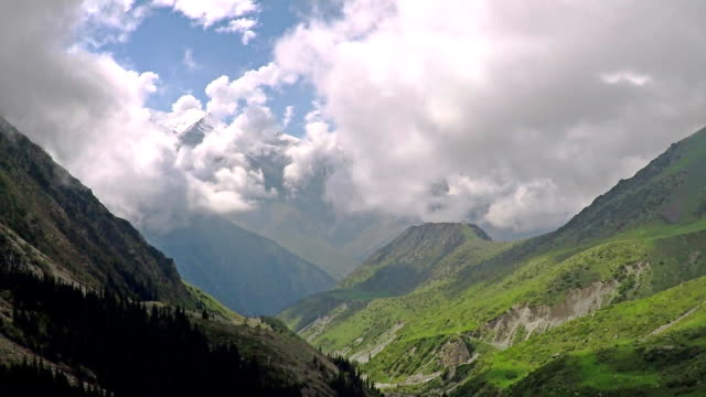Aerial shot of summer mountain valley and clouds. Kyrgyzstan mountains video