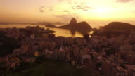 Aerial shot of the city of rio de janeiro in the middle of the mountain of Sugar Loaf Mountain in the twilight, with a slight movement video