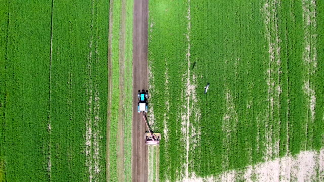 Aerial shot of tractor spraying field video