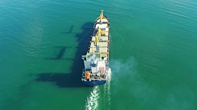 Aerial shot of trade ship in ocean. video