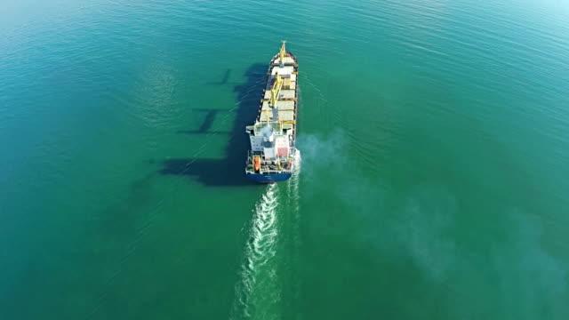 Aerial shot of trade ship in ocean. video