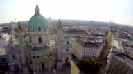 Aerial shot of Vienna Karlskirche, Baroque building, tourism air. Beautiful aerial shot above Europe, culture and landscapes, camera pan dolly in the air. Drone flying above European land. Traveling sightseeing, tourist views of Austria. video
