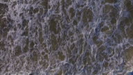 Aerial shot of waves crashing on a beach. video