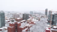 Aerial shot over a snow covered city video