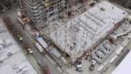 Aerial shot over a steel structure being constructed video