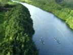 Aerial shot three outrigger canoes on river 2 video