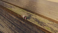 Aerial shot, tractor plowing a field. video
