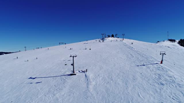 Aerial - Ski lift at ski resort in sunny Carpatian mountains video