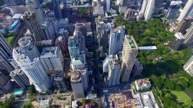 Aerial: Skyscrapers and traffic in Bangkok. video