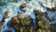 aerial slow motion video of waves crushing on the rocks video
