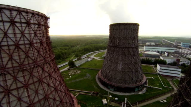 Aerial Stock Footage Flight Between Power Plant Towers video