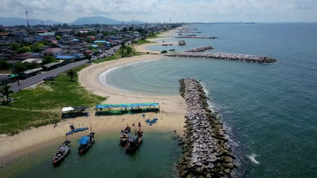 Aerial. Stone wave breaker into the sea at Map ta phut Industrail Estate, Rayong, Thailand video