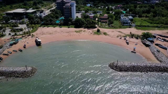 Aerial. Stone wave breaker into the sea at Pattaya, Chonburi, Thailand video