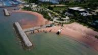 Aerial. Stone wave breaker into the sea at Pattaya, Chonburi, Thailand video