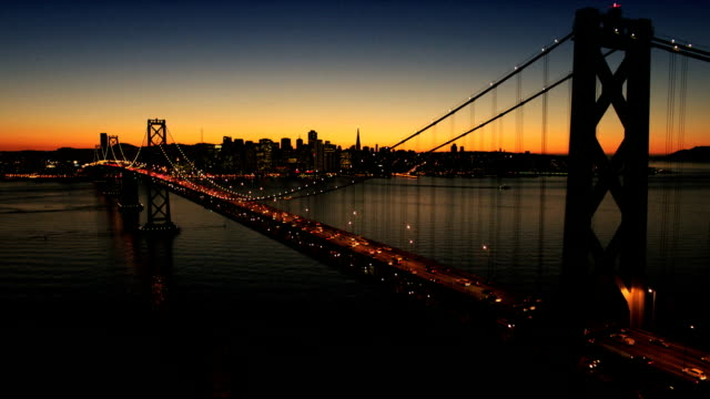 Aerial sunset view of the Oakland Bay Bridge, USA video