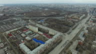 Aerial survey on city. View from the sky on Russian city. Aerial city view on houses, streets and parks. Grey sky and garages really residential district. Aerial survey on the street where drive a lot of car.Chelyabinsk. Ural. Overhead Aerial Flight Over video