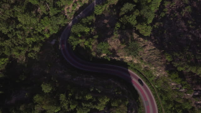 aerial time lapse shot of sharp curve road video