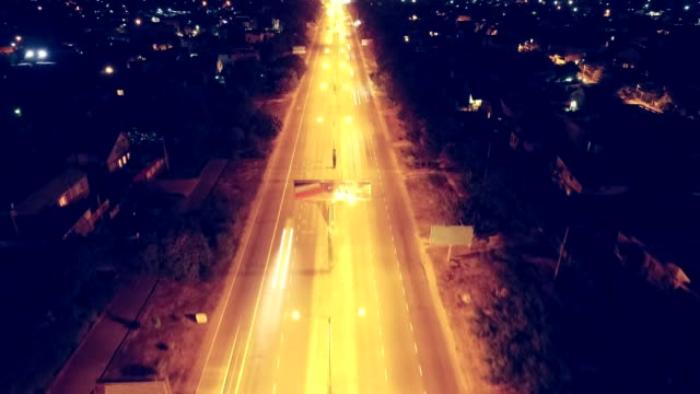 Aerial timelapse of suburban road and traffic going to city video